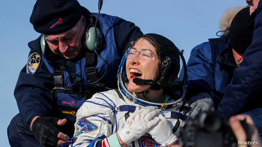 NASA astronaut Christina Koch reacts shortly after landing of the Russian Soyuz MS-13 space capsule in a remote area southeast…