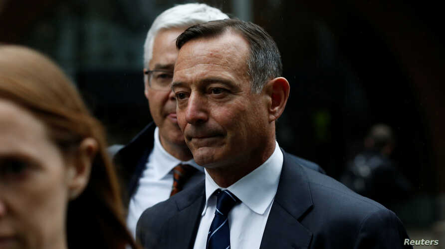 Douglas Hodge, the former chief executive of the investment firm Pimco, leaves the federal courthouse after being sentenced in…
