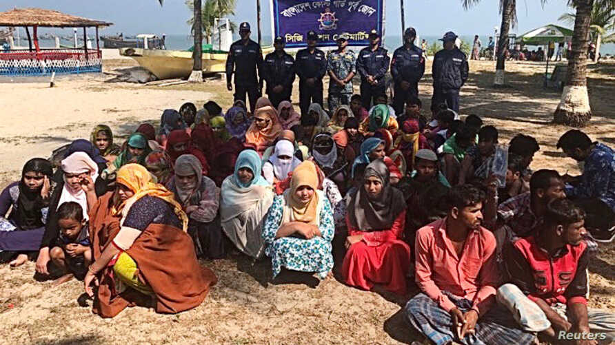 Rohingya refugees wait after their boat capsized near the Saint Martin's island in the Bay of Bengal, in Teknaf, near Cox's…