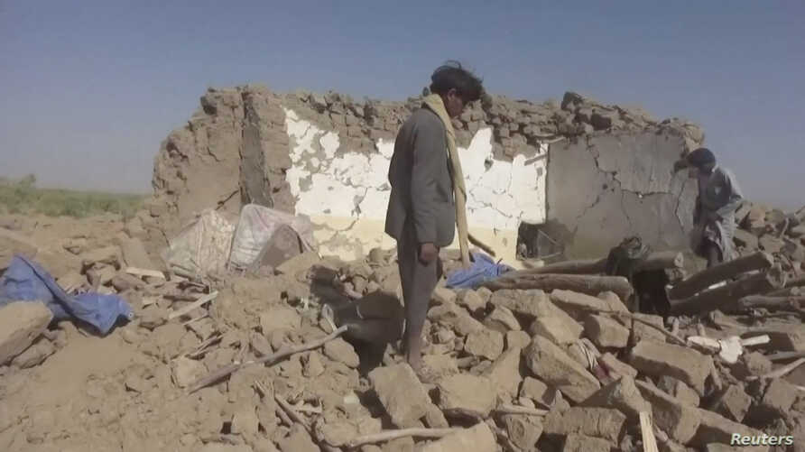 People rummage through rubble after an air strike in Al-Jawf province, Yemen, February 15, 2020 in this still image taken from…