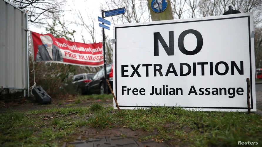 A sign is seen outside Woolwich Crown Court, ahead of a hearing to decide whether Julian Assange should be extradited to the…