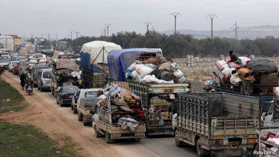 FILE PHOTO: A general view of vehicles carrying belongings of internally displaced Syrians from western Aleppo countryside, in…