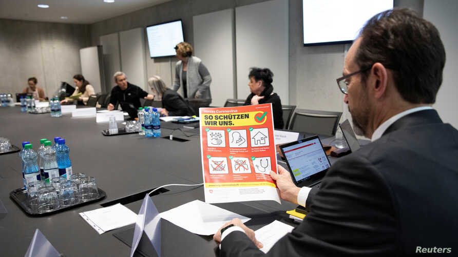 Pascal Strupler, Director-General of the Federal Office of Public Health, holds a flyer prior to a meeting of the task force of…