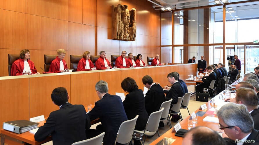 President of Germany's Constitutional Court Andreas Vosskuhle reads the verdict of the court about the attempt by the country's…