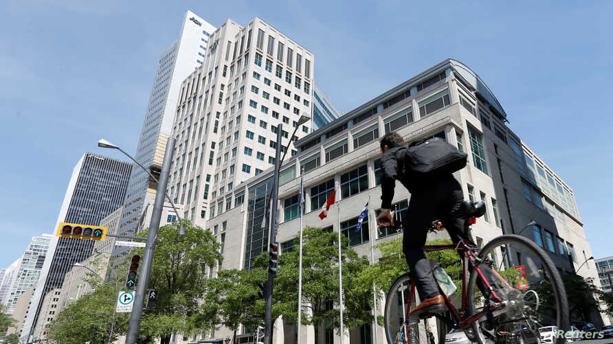 A man cycles past the International Civil Aviation Organization (ICAO) headquarters building in Montreal, Quebec, Canada June…