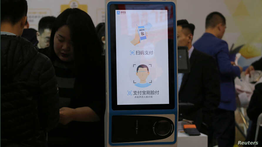A machine with Alipay's facial recognition payment system is displayed at a smart business fair in Nanjing, Jiangsu province,…
