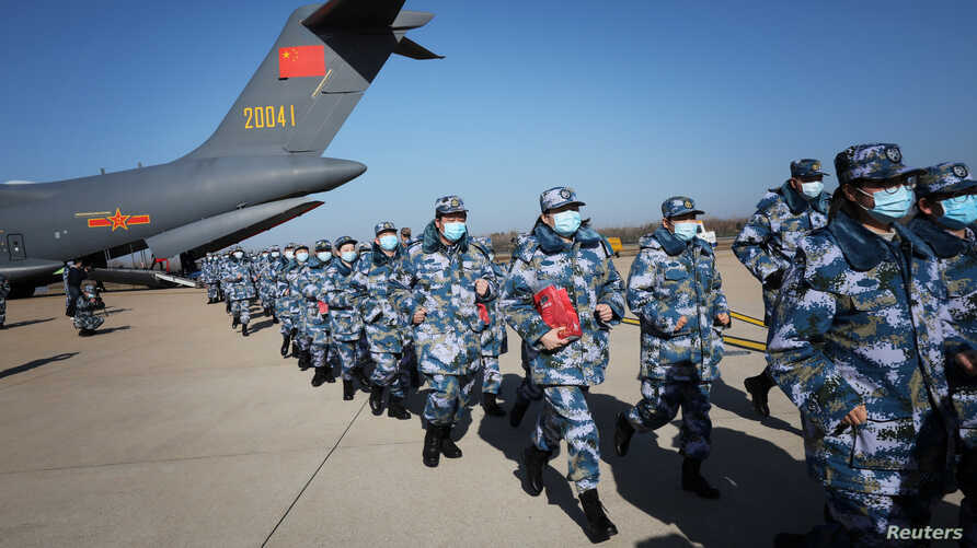 Medical personnel arrive in transport aircraft of the Chinese People's Liberation Army (PLA) Air Force at the Wuhan Tianhe…