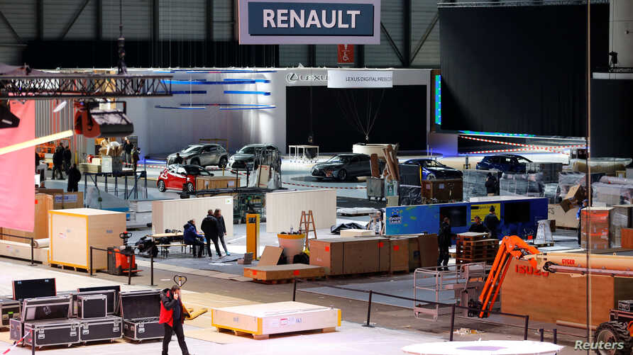 Cars and workers are pictured at the Palexpo exhibition centre as the 90th edition of the International Motor Show is cancelled…