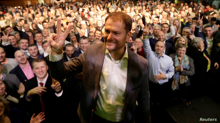 Ordinary People and Independent Personalities (OLaNO) party leader Igor Matovic gestures with  supporters at his party's…
