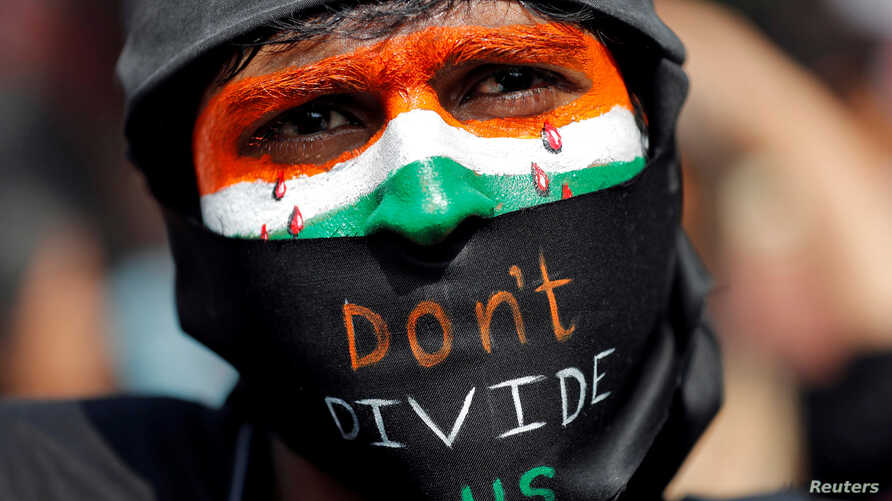 A demonstrator attends a protest against riots following clashes between people demonstrating for and against a new citizenship…
