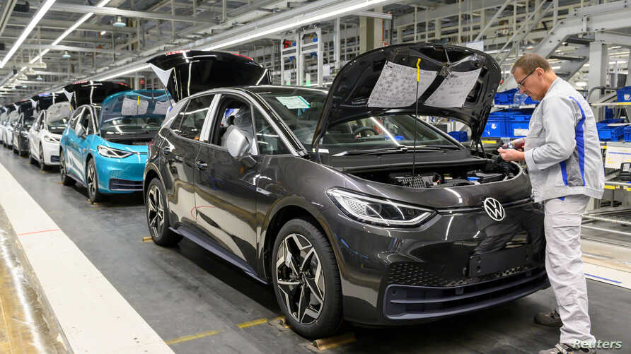 FILE PHOTO: An employee works at a production line of the electric Volkswagen model ID.3 in Zwickau, Germany, February 25, 2020…