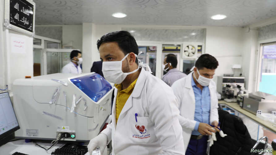 Medical staff wear face masks at a hospital amid concerns of the spread of the coronavirus disease (COVID-19) in Sanaa, Yemen…