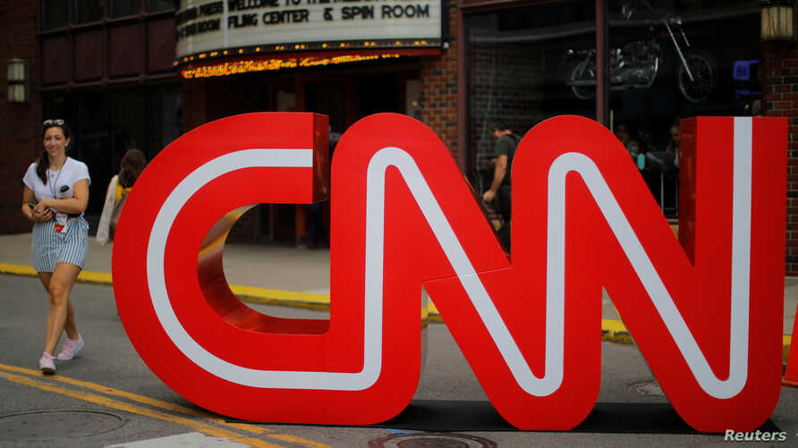 The CNN logo stands outside the venue of the second Democratic 2020 U.S. presidential candidates debate, in the Fox Theater in…