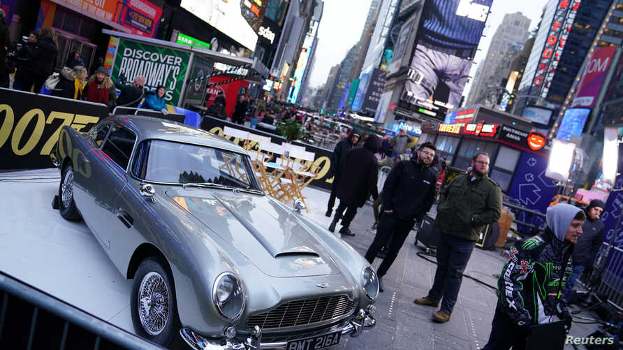 "An Aston Martin DB5 is pictured during a promotional appearance on TV in Times Square for the new James Bond movie ""No Time to…"