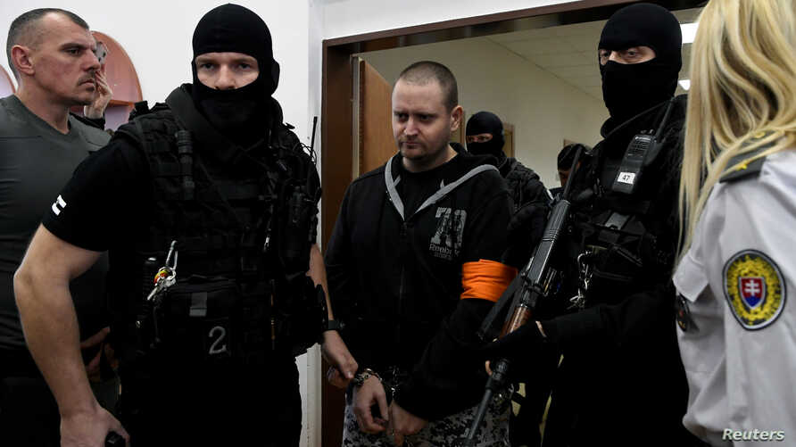FILE PHOTO: Miroslav Marcek walks inside the courtroom at a preliminary hearing as he and other defendants appear on charges of…