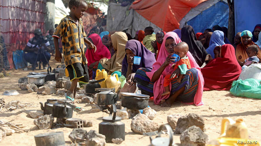 Somali families, displaced after fleeing the Lower Shabelle region amid an uptick in U.S. airstrikes, wait at an IDP …