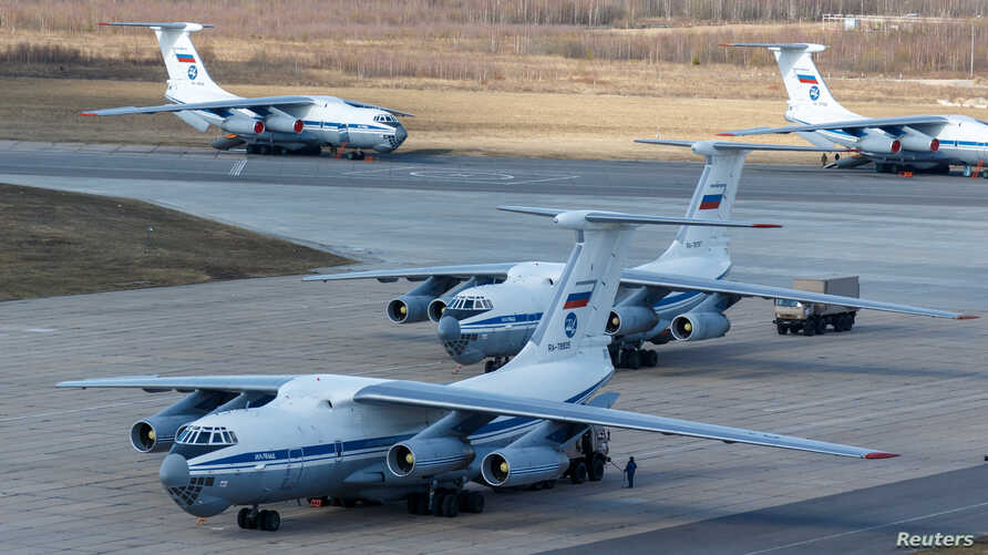Russian servicemen load medical equipment and special disinfection vehicles into cargo planes while sending the supply to Italy…