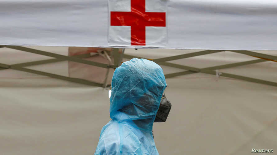 A medical specialist wearing a protective suit is seen at a makeshift rapid testing center for coronavirus disease (COVID-19),…