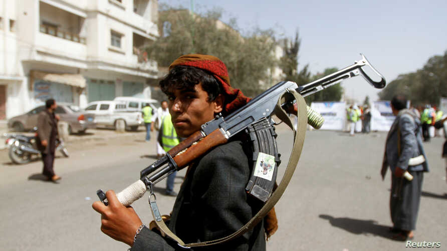 FILE PHOTO: A Houthi supporter looks on as he carries a weapon during a gathering in Sanaa, Yemen April 2, 2020. REUTERS…