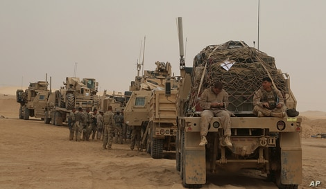 In this Nov. 7, 2017, photo,  U.S. Marines prepares to build a military site in western Anbar, Iraq.  The US-led coalition's outpost in the fight against the Islamic State group is in a corner of western Iraq near the border with Syria.
