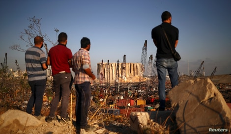 People view the damaged site of Tuesday's blast in Beirut's port area, Lebanon, Aug. 7, 2020.