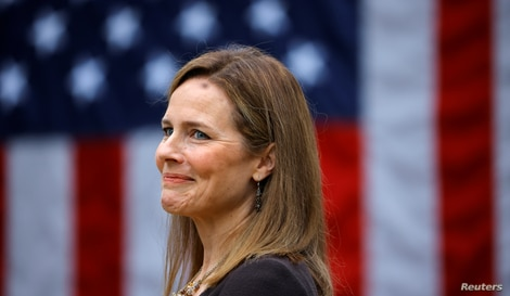 U.S. Court of Appeals for the Seventh Circuit Judge Amy Coney Barrett reacts as U.S President Donald Trump holds an event to…