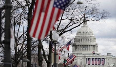 Flags are in place near the Capitol ahead of the inauguration of President-elect Joe Biden and Vice President-elect Kamala Harris, in Washington, Jan. 17, 2021.
