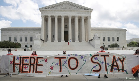 FILE - DACA recipients and their supporters celebrate outside the U.S. Supreme Court after the court ruled in a 5-4 vote that U.S. President Donald Trump's 2017 move to rescind DACA, was unlawful, Washington, June 18, 2020.