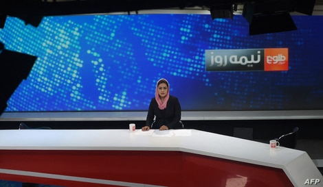 FILE - Afghan host Zarmina Mohammadi for Tolo News is seen during a live broadcast at Tolo TV studios in Kabul, Afghanistan, Sept. 11, 2018.