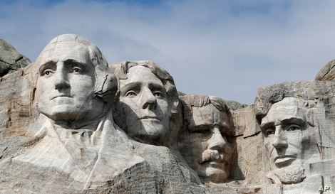 FILE - This March 22, 2019, file photo shows Mount Rushmore in Keystone, S.D.  President Donald Trump will begin his…