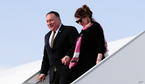 U.S. Secretary of State Mike Pompeo, left, arrives with his wife Susan Pompeo, right, at the airport in Prague, Czech Republic,…