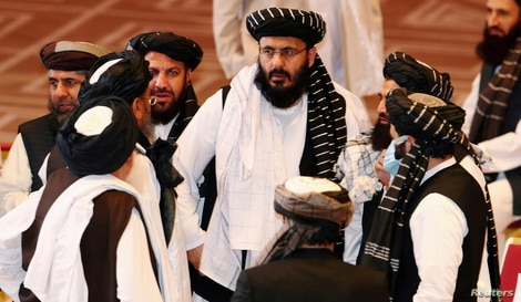 FILE PHOTO: Taliban delegates speak during talks between the Afghan government and Taliban insurgents in Doha, Qatar