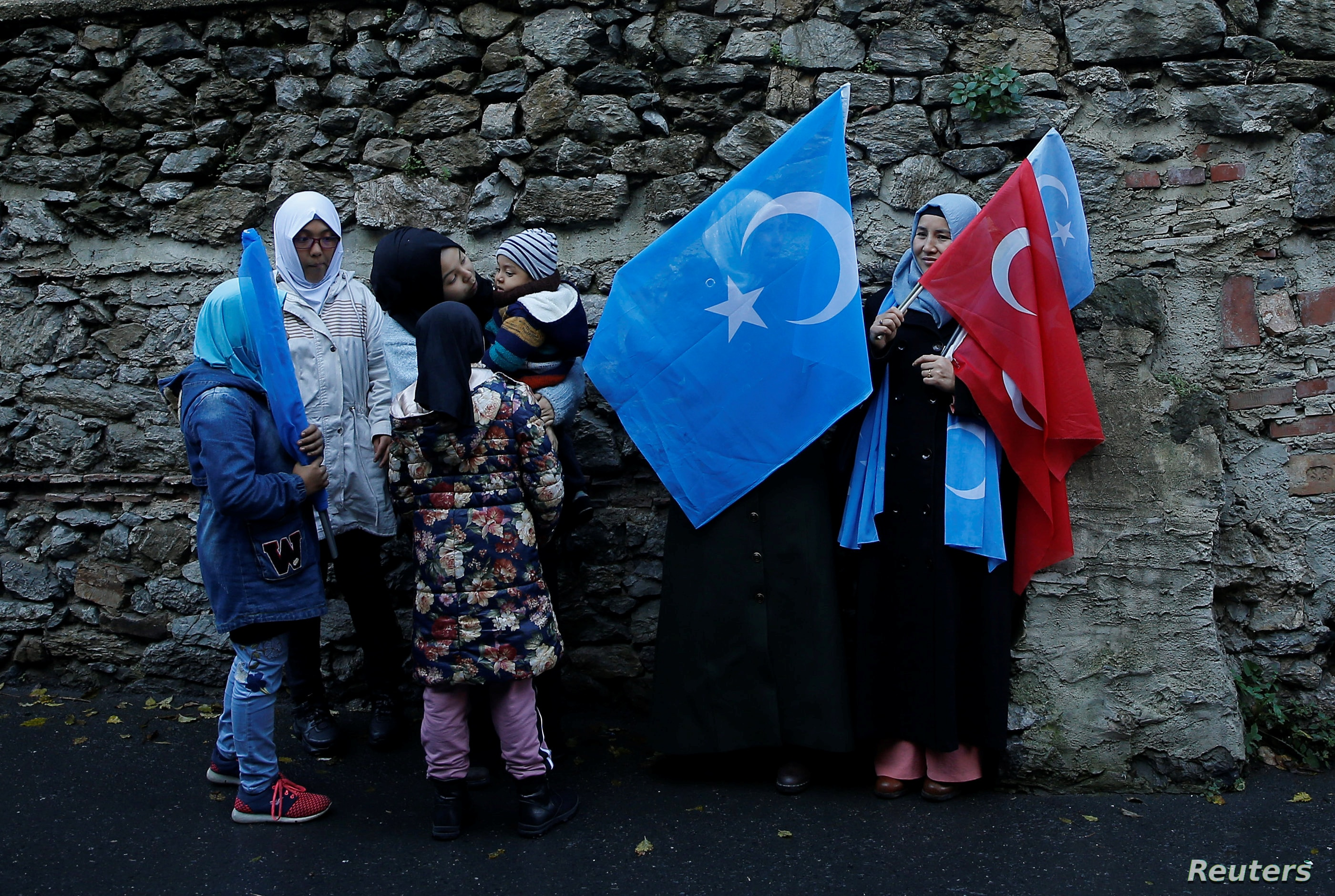 Ethnic Uighur women are seen during a protest against China near the Chinese Consulate in Istanbul Turkey