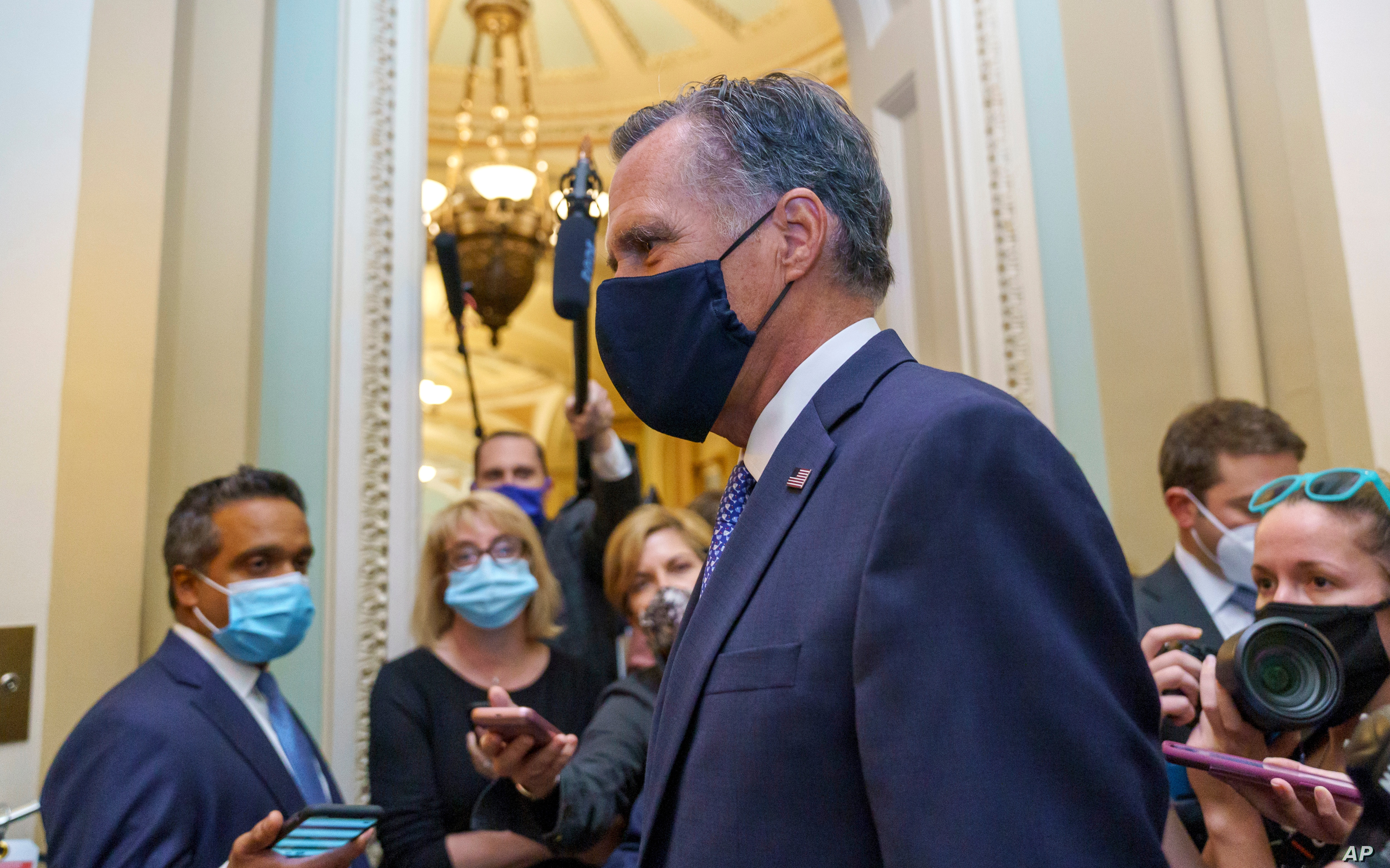 Sen. Mitt Romney R-Utah leaves the Senate Chamber following a vote at the Capitol in Washington Sept. 21 2020
