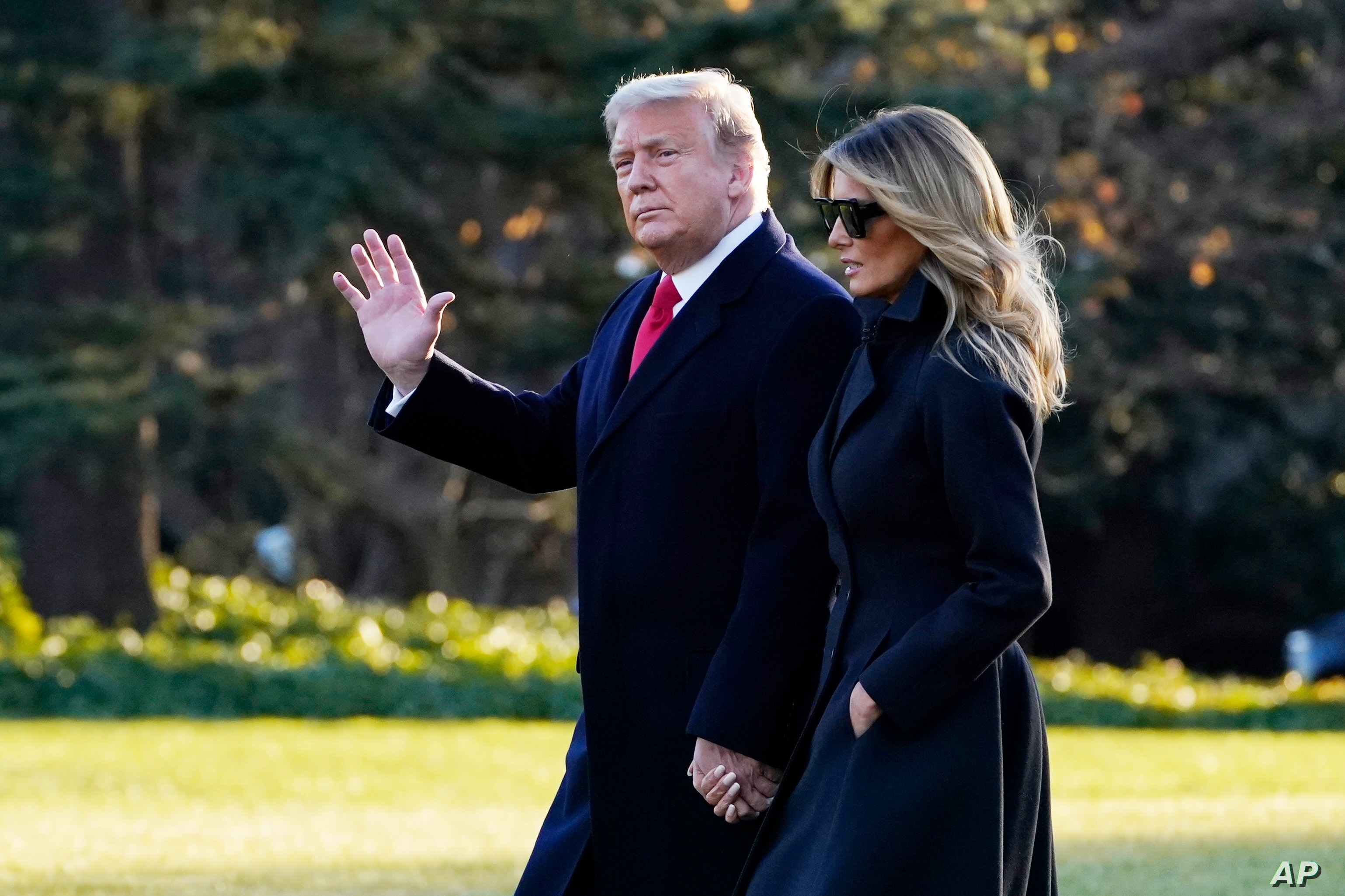 Trump Signs Spending Bill Pandemic Aid Package Voice Of America English