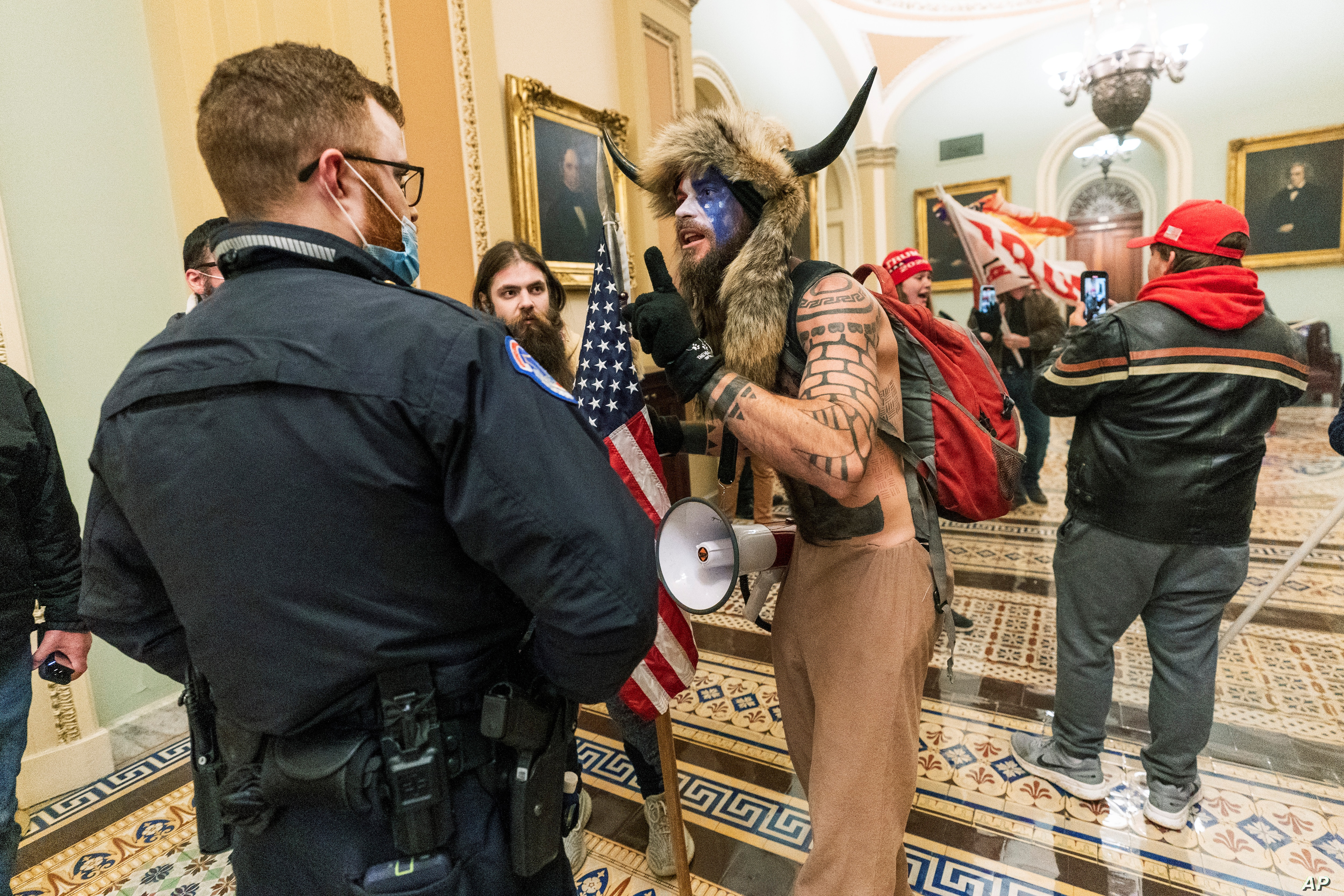 Donald Trump are confronted by U.S. Capitol Police officers