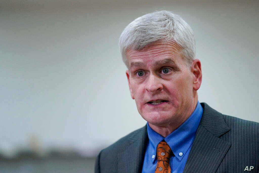 Sen. Bill Cassidy R-La. talks with reporters on Capitol Hill in Washington Thursday Feb. 11 2021 at the conclusion of the
