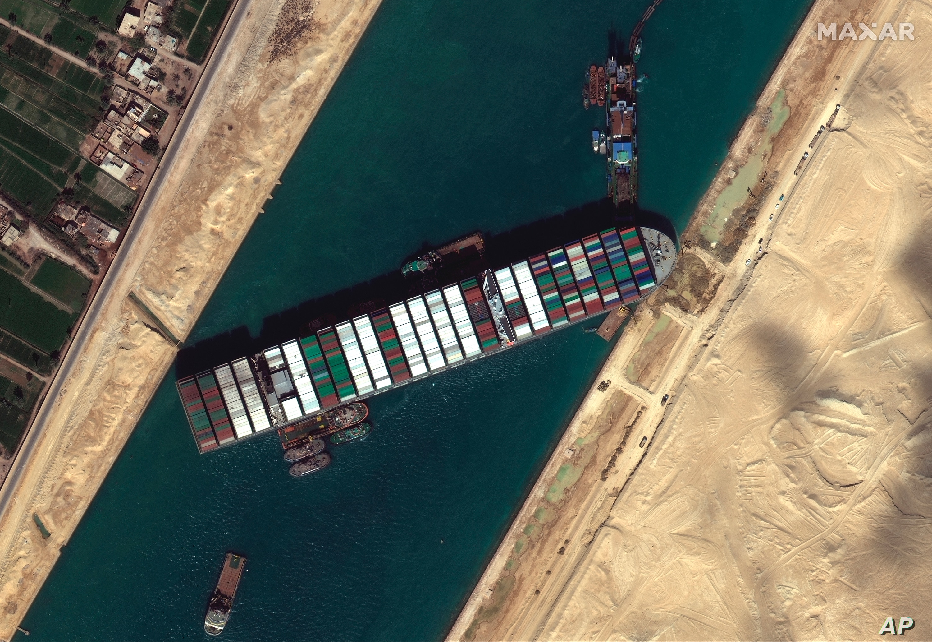 Optimism but concern as ship stuck in Suez