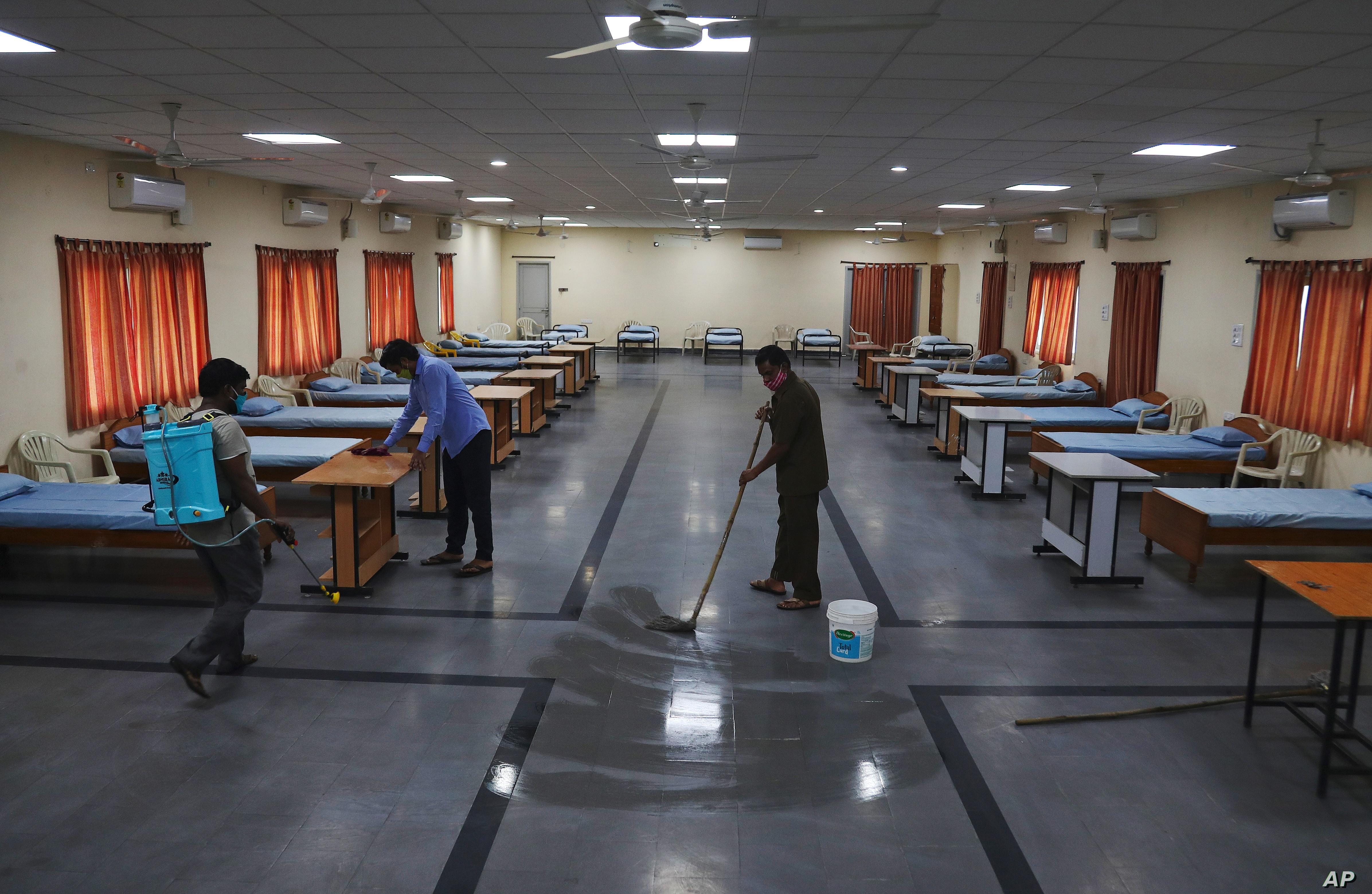 Indian workers disinfect an isolation center for COVID-19 positive people in Hyderabad India