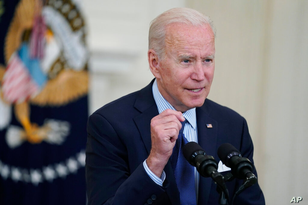 President Joe Biden speaks about the COVID-19 vaccination program in the State Dining Room of the White House Tuesday May 4