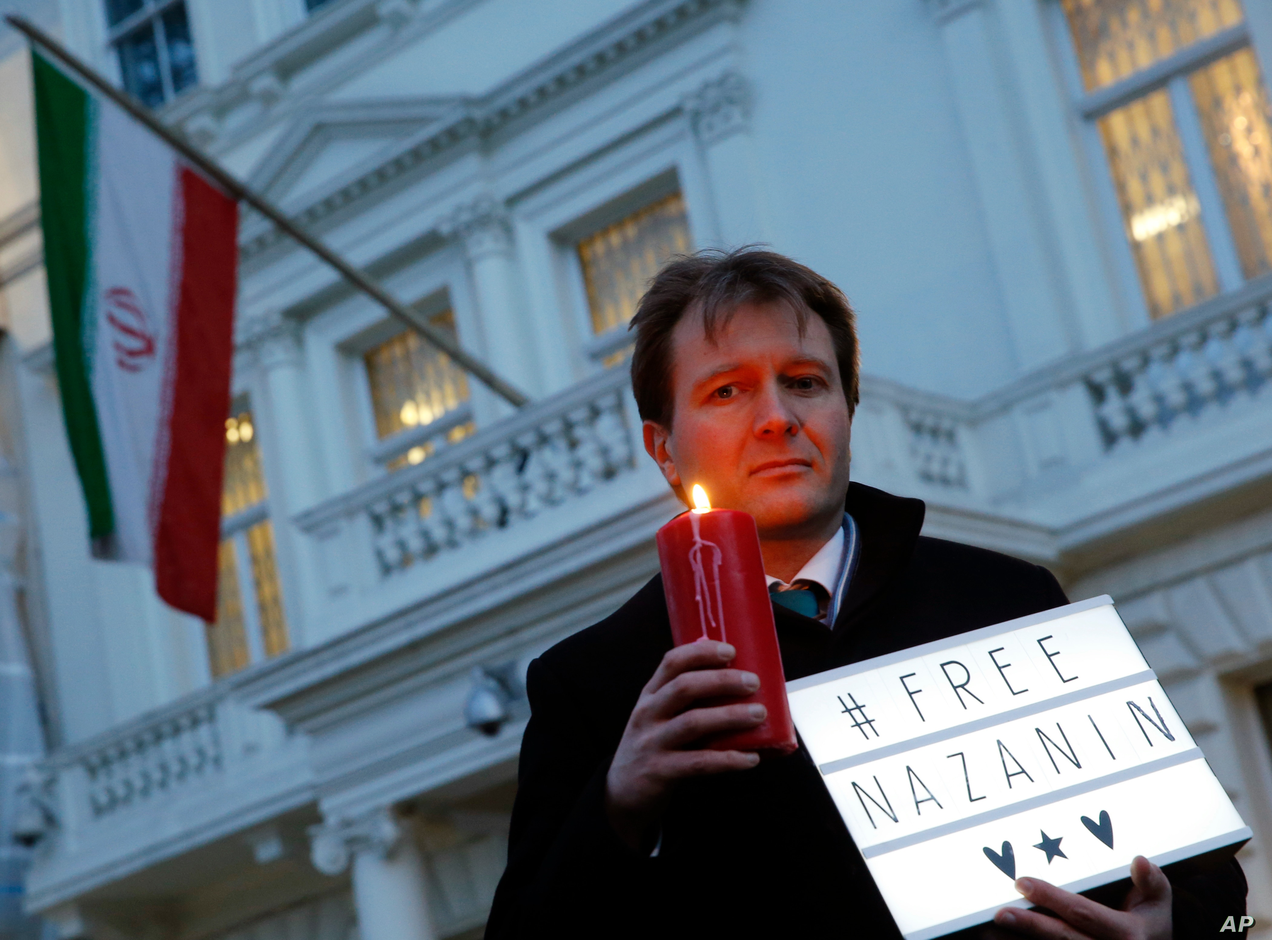 FILE- Richard Ratcliffe husband of charity worker Nazanin Zaghari-Ratcliffe imprisoned in Iran calls for his wife's release outside the Iranian Embassy in London Jan. 16 2017