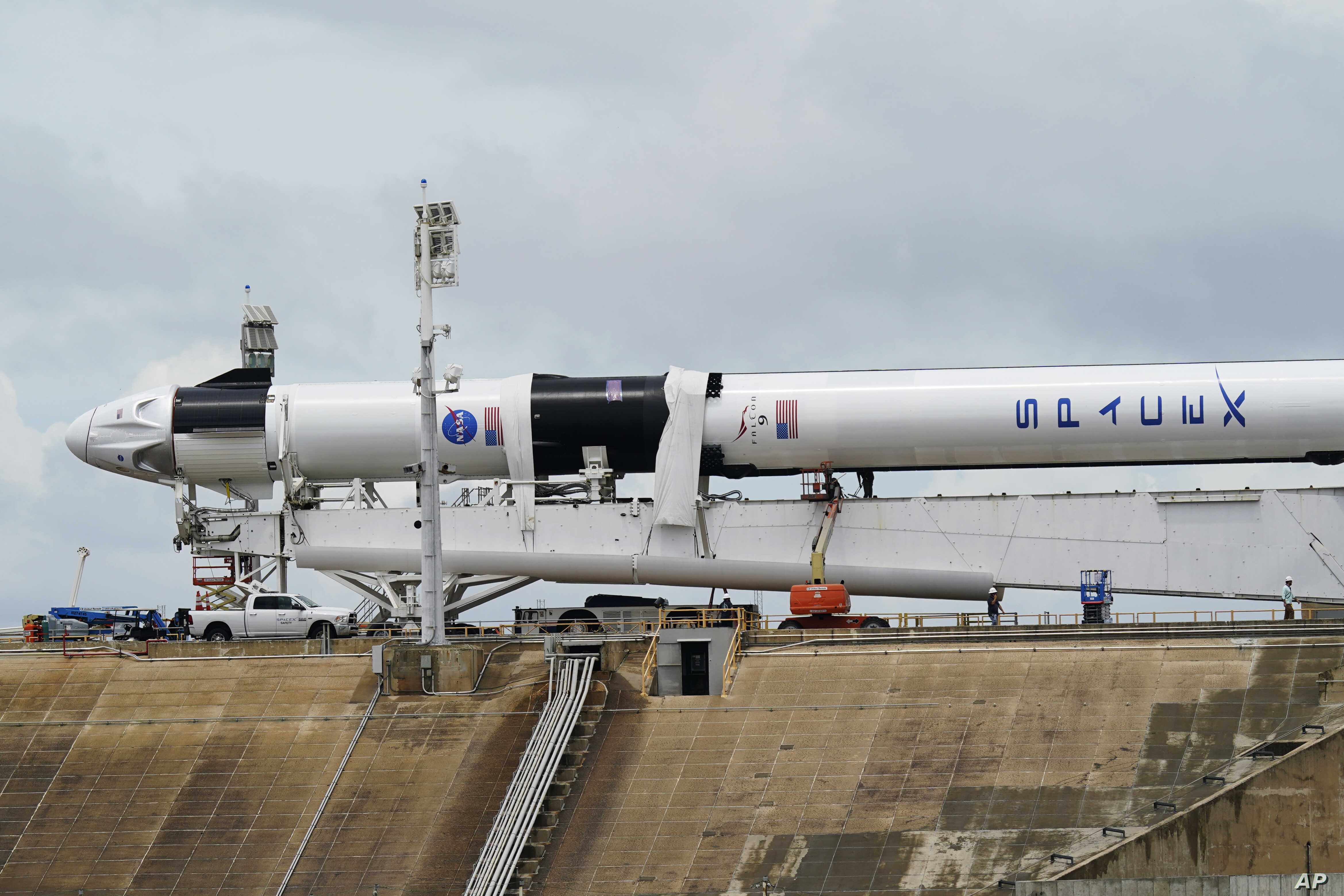 SpaceX's first astronaut launch threatened by stormy weather