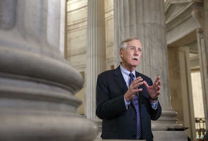 Senate Intelligence Committee member, Sen. Angus King, I-Maine, defends the panel's planned release of a report on the CIA's harsh interrogation techniques, Tuesday, Dec. 9, 2014, during a TV news show interview on Capitol Hill in Washington.  (AP Ph...