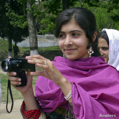 Malala Yousufzai, a 14-year-old schoolgirl, who was wounded in a gun attack, is seen in Swat Valley, northwest Pakistan, in this undated file photo.
