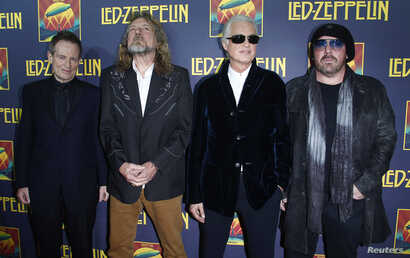 FILE - Members of British rock band Led Zeppelin, left to right, bass player John Paul Jones, lead singer Robert Plant, guitarist Jimmy Page and drummer Jason Bonham, who replaces the band's original drummer his father John Bonham, arrive for the pre...