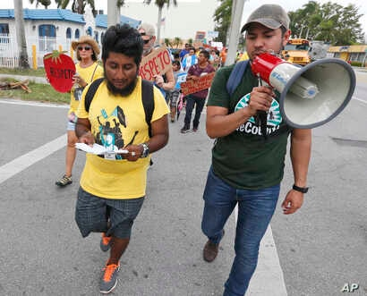 Jose Luis Santiago (left) an immigration advocate, marches during a protest march in Homestead, Fla. Cinco de May, a once-obscure holiday marking a 19th century-battle between Mexico and invading French forces, is being met with ambivalence by Mexica...