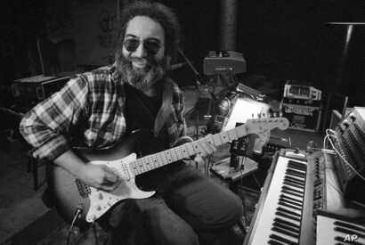 Jerry Garcia, leader of the legendary group,The Grateful Dead, works with his guitar, May 8, 1979.