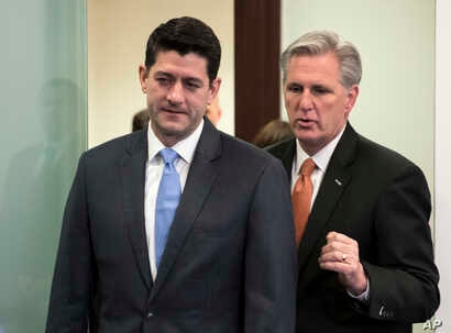 Speaker of the House Paul Ryan, R-Wisconsin, left, and Majority Leader Kevin McCarthy, R-California, confer as they arrive to meet with reporters following a closed-door GOP strategy session at the Capitol in Washington, Feb. 6, 2018.