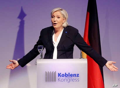 Far-right leader and candidate for next spring presidential elections Marine le Pen from France delivers a speech in Koblenz, Germany,  Jan. 21, 2017.