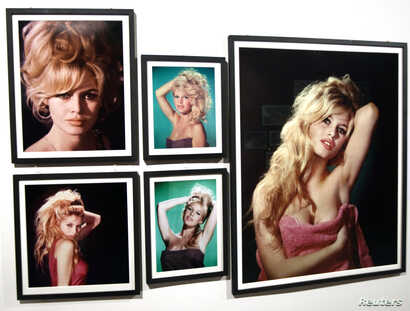 FILE - Pictures of former actress Brigitte Bardot are displayed during a media preview of an exhibition in Boulogne-Billancourt, western Paris, Sept. 25, 2009.